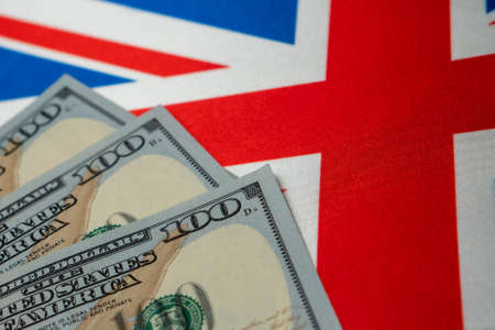 Great Britain national flag and the dollar bills. Business and finance concept, soft focus