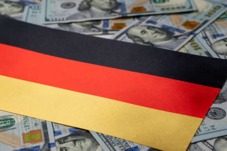 Germany Flag with US dollars as background. Concept for investors, soft focus