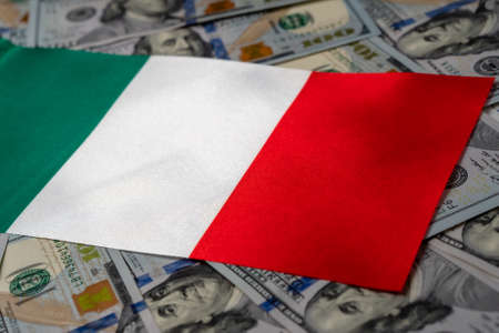 Italy flag with US dollars as background. Concept for investors, soft focus Foto de archivo