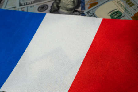 France flag with US dollars as background. Concept for investors, soft focus Foto de archivo