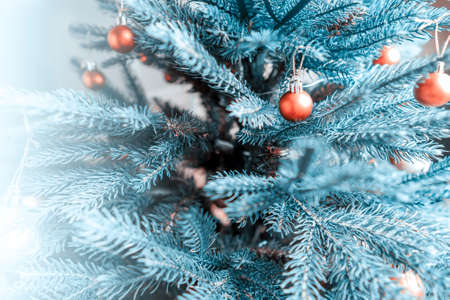 Beautiful silver decorations on a Christmas tree. Close-up, soft focus