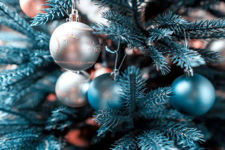 Beautiful silver decorations on a Christmas tree. Close-up, soft focus.