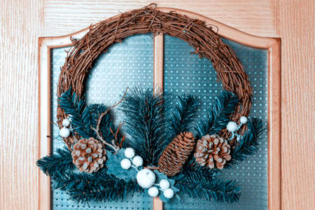 Christmas wreath decorates the door of the room.