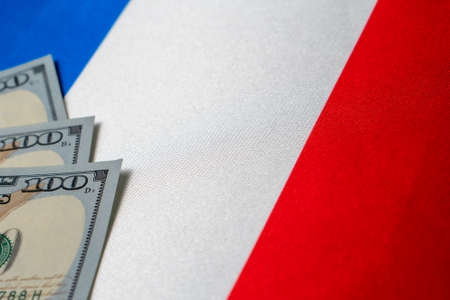 France national flag and the dollar bills. Business and finance concept, soft focus