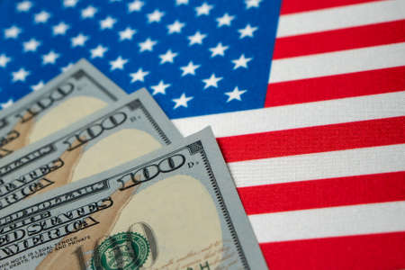 USA national flag and the dollar bills. Business and finance concept, soft focus Foto de archivo