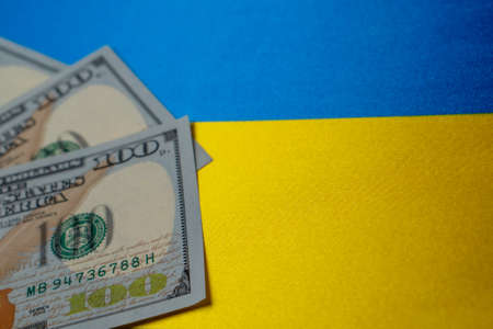 Ukraine national flag and the dollar bills. Business and finance concept, soft focus Foto de archivo