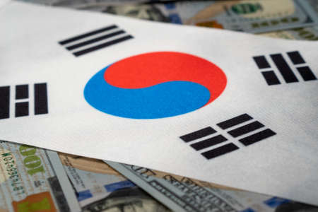 Republic of Korea flag with US dollars as background. Concept for investors, soft focus