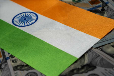 India flag with US dollars as background. Concept for investors, soft focus Foto de archivo