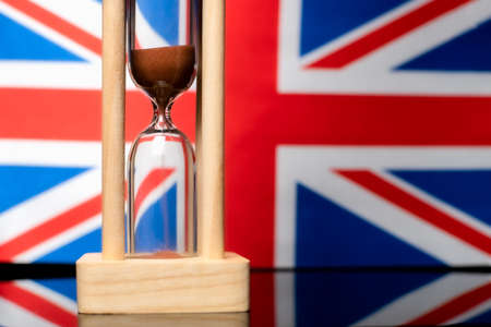 Hourglass and Great Britain flag, soft focus, copy space Foto de archivo