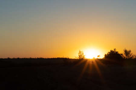 Natural sunset or sunrise over the field. Countryside