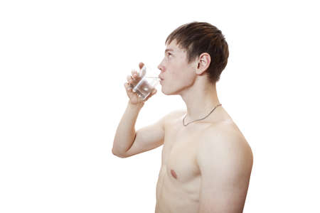 The young man drinks water  photo
