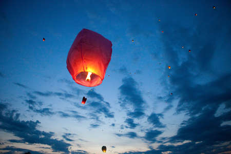 The Chinese lantern flies up highly in the sky  photo
