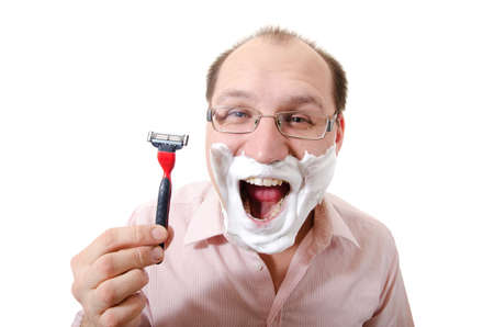 The young man has a shave, isolated on white.