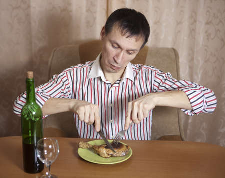 The young man eats at the table Stock Photo - 17567355