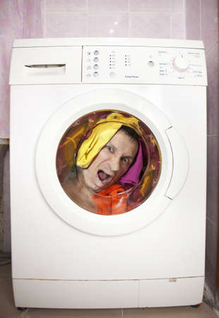 man inside Washing machine. photo