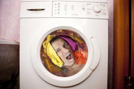 wash face: man inside Washing machine. Stock Photo