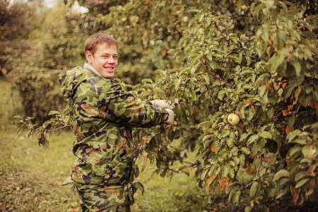 Gardener is working in the garden  photo