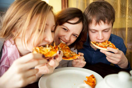 eating pizza: Portrait  Stock Photo