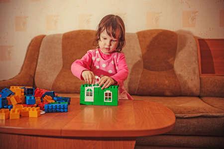 Little girl playing lego blocks  Stock Photo