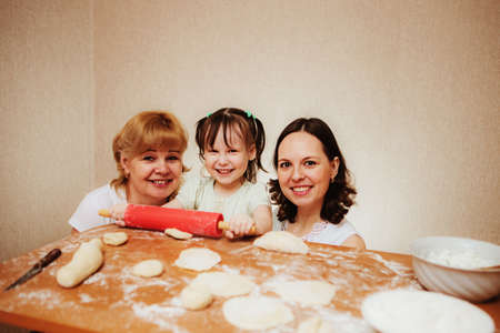 backing: smiling family backing some pies