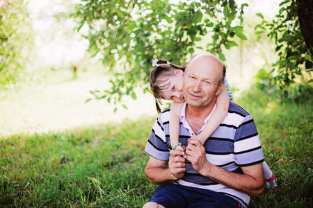 Grandfather and granddaughter Stock Photo