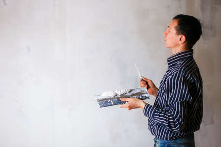 dub: Plastering. Stock Photo