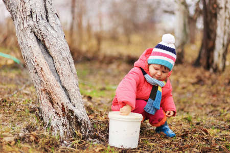 wood agricultural: The child in garden happiness outdoors work. Stock Photo