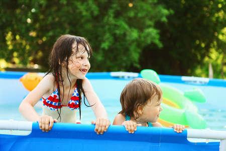 water garden: Children swim in the pool in garden.