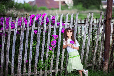 The Little girl walk in the village.