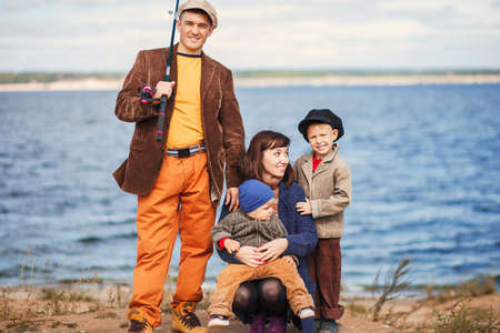 The Great family fishing on the river.