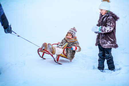 Two ittle childs playing snow in the outdoor