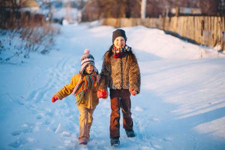 The Children playing outside in the winter.
