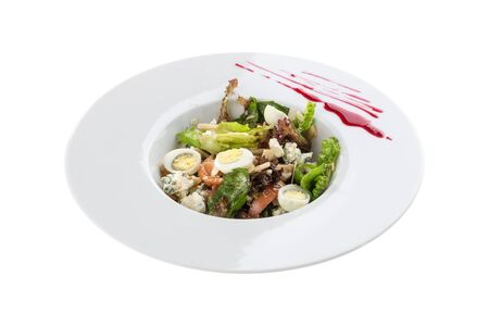 fresh salad with gorgonzola cheese and egg in white bowl isolated on white background side view
