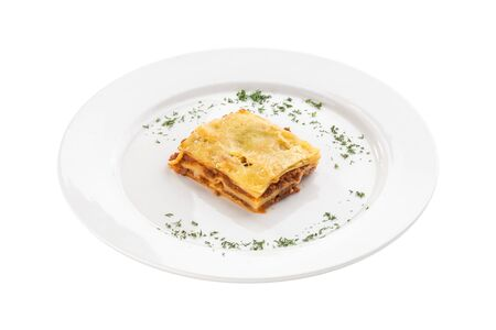 Piece of homemade Lasagne with beef isolated on white background side view Stock Photo