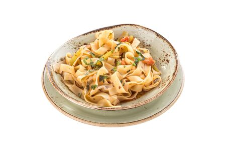 Pasta fettuccine with salmon on grey plate isolated on a white background side view 写真素材