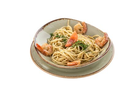 fresh spaghetti pasta with prawn on grey plate isolated on white background side view