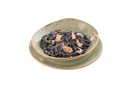 Fresh black pasta with chicken and herbs isolated on white background side view 写真素材