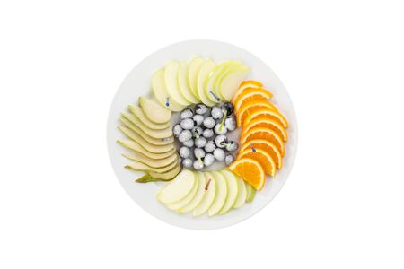 Raw fruits assortment platter with orange, pear, grape and apple sliced isolated on white background top view