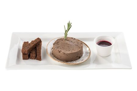 Chicken liver pate with cranberry sauce served with rye bread croutons isolated on white background side view