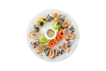 Canapes with smoked fish appetizer platter isolated on white background top view