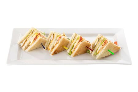 Club sandwiches with chicken, bacon, cheese and pickle isolated on white background side view Stock Photo