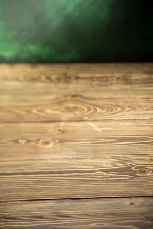 empty Wooden table selective focus green wall background mock up