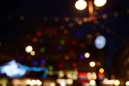 Defocused colorful urban abstract bokeh city lights which can be used as overlay texture