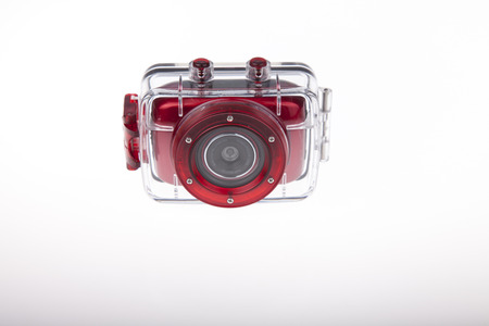 Underwater red action video camera with plastic waterproof case