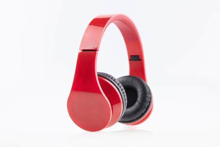 padding: Red earphones with black padding, white isolate
