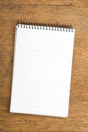 Spiral Notepad on wooden table Stock Photo - 3241558
