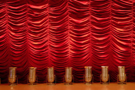 Red stage curtain with spotlights