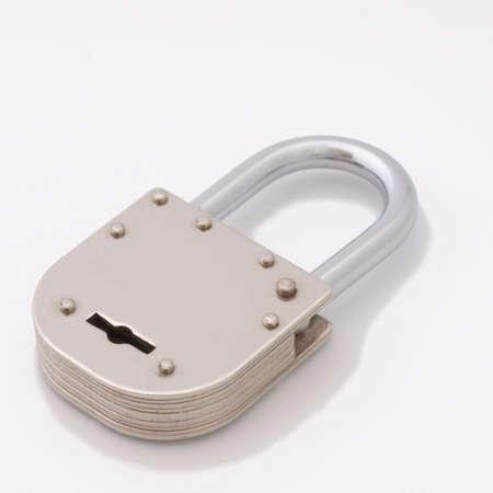 unleash: Closed old style padlock isolated on white background