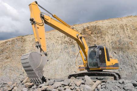 back hoe: Large Bulldozer Excavator With Rocks