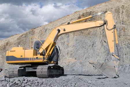 excavate: Large Bulldozer Excavator With Rocks